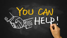 You can help. Handwritten on blackboard Royalty Free Stock Image