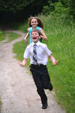 You can not catch me!. Teenager girl catches a teenager boy on a forest path