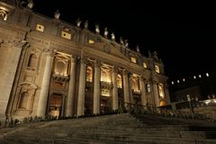 St. Peter`s Basilica at night. You can see the porch where Pope usually addresses the world Royalty Free Stock Image