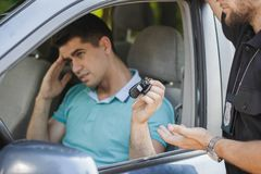 You can't drive under the influence of alcohol, give me your keys Royalty Free Stock Photography