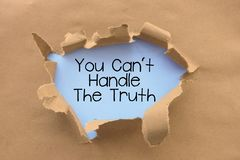 You can`t handle the truth saying behind torn brown paper or cardboard stock photos