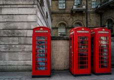 You Can`t Miss the Iconic Telephone Booths. You can`t miss the iconic red telephone booths on the  streets of London Royalty Free Stock Photos