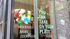 You can take on your plate sign on glass of restaurant. At downtown Vancouver stock footage
