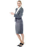 You can use this way to reception. Female executive showing empty copy space Royalty Free Stock Images