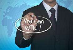 You Can Win businessman write concept. Over light blue background with map world Royalty Free Stock Photos