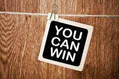 You Can Win. Written Motivation Concept on Board Stock Images