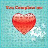 You complete me puzzle with red heart. You complete me Jigsaw puzzle pieces make up the words You complete me on a pretty aqua background Stock Image