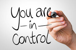 You are in Control hand writing with a black mark on a transparent board Royalty Free Stock Images