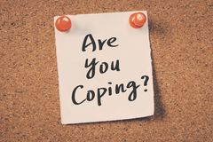 Are you coping. Concept message on a cork board Stock Photos