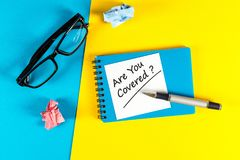 ARE YOU COVERED Question message at your workplace. Are you insured for your car, travel, home, health or other. Liability Royalty Free Stock Images