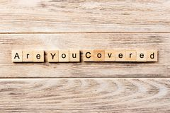 Are you covered word written on wood block. are you covered text on table, concept.  royalty free stock images