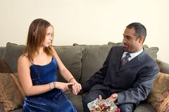 You are definitely Late. Teenage girl telling man that he is definitely late stock photos