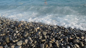 You definitely need summer!. Stones and the sea in Nice, France Stock Image