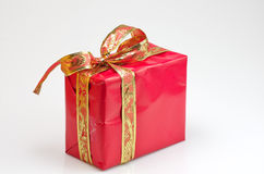 You deserve it. Red gift box with gold decoration Royalty Free Stock Photo