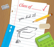 You Did It. Table top with school supplies and a binder paper with text that says, class of, you did it, and a drawing of a graduation cap. Eps10 Stock Image