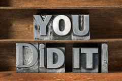 You did it tray. You did it exclamation made from metallic letterpress type on wooden tray royalty free stock images