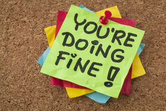 You are doing fine. Self assurance reminder or compliment - handwriting on green sticky note Royalty Free Stock Photography