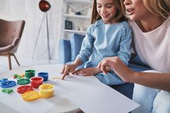 You are doing so well! Mother and daughter painting with fingers stock images