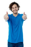 You are done a good job !. Happy young man showing thumbs up gesture Royalty Free Stock Images