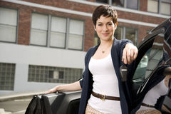 You Drive Sales Agent Hands You Keys to New Car. A pretty woman hands you the car keys Stock Photo