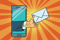 You email or a message in smartphone. Pop art retro vector illustration Royalty Free Stock Photos