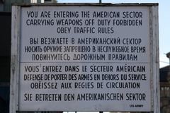 You are entering the American sector. Berlin, Germany - March 19, 2018: You are entering the American sector. Carrying weapons off duty forbidden. Obey traffic Stock Photos