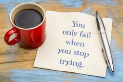 You only fail when. You stop trying - handwriting on a napkin with a cup of coffee stock photos
