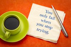 You only fail when. You stop trying - inspirational handwriting on a napkin with coffee royalty free stock image