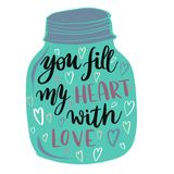 You fill my heart with love lettering message. Glass jar with lettering message You fill my heart with love Royalty Free Stock Image