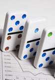 You financial future is no game. Dominos on stock report royalty free stock photography