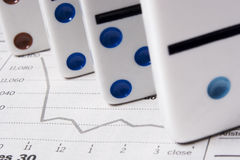 You financial future is no game. Dominos on stock report stock photos