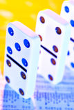 You financial future is no game. Dominos on stock report royalty free stock photo