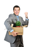 You are fired!. Young happy businessman hold cardboardbox with personal belongings. Isolated on white background Royalty Free Stock Image