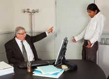 You are fired. Very angry director firing one of his young employees Royalty Free Stock Image