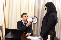 You are fired!. Furious manager man shouting in megaphone to an employee woman:You are fired Stock Image