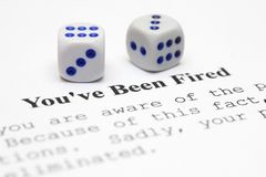 You are fired. Close up of dice on You are fired form Stock Images