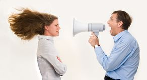 You are fired!. Image of strict boss shouting at businesswoman through loudspeaker so loudly that her hair being blown by strong wind Royalty Free Stock Image