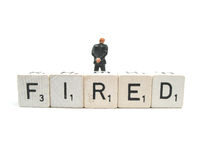 You are fired !. A paerson walking away from the word fired Stock Images
