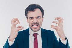 You are fired! Close up portrait of aggressive terrifying  frigh. Tening demonstrating teeth gesturing with hands boss wearing red tie dark blue jacket isolated Stock Photo