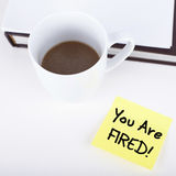 You Are Fired!. Cup of coffee and adhesive note with ' You Are Fired Stock Photo