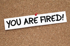 You Are Fired!. Note pinned on cork bulletin board Royalty Free Stock Image