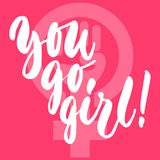 You go, girl - hand drawn lettering phrase about woman, female, feminism on the pink background. Fun brush ink. Inscription for photo overlays, greeting card or Royalty Free Stock Image