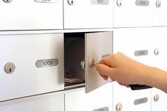 You got mail. Macro woman opening mail box Stock Image