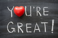 You are great. Phrase handwritten on school blackboard Royalty Free Stock Photos