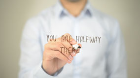 You Are Halfway There , man writing on transparent screen Stock Image