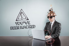 You have been hacked text with vintage businessman using laptop Stock Images