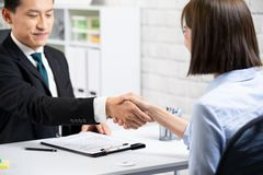 You have been hired. Business people handshake after a successful job interview royalty free stock photos