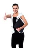 You have done a great job!. Smiling female executive showing thumbs up Royalty Free Stock Photo