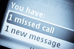 You Have Mail. Close up of a cell phone noting missed call and voice mail Stock Photos