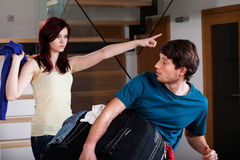 You have to move out. An angry wife asking her husband to move out of their apartment Royalty Free Stock Photo